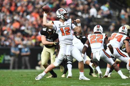 Oregon State Beavers quarterback Jack Colletto (12) passes in the first quarter against the Colorado Buffaloes at Folsom Field on Oct. 27, 2018. Mandatory Credit: Ron Chenoy-USA TODAY Sports
