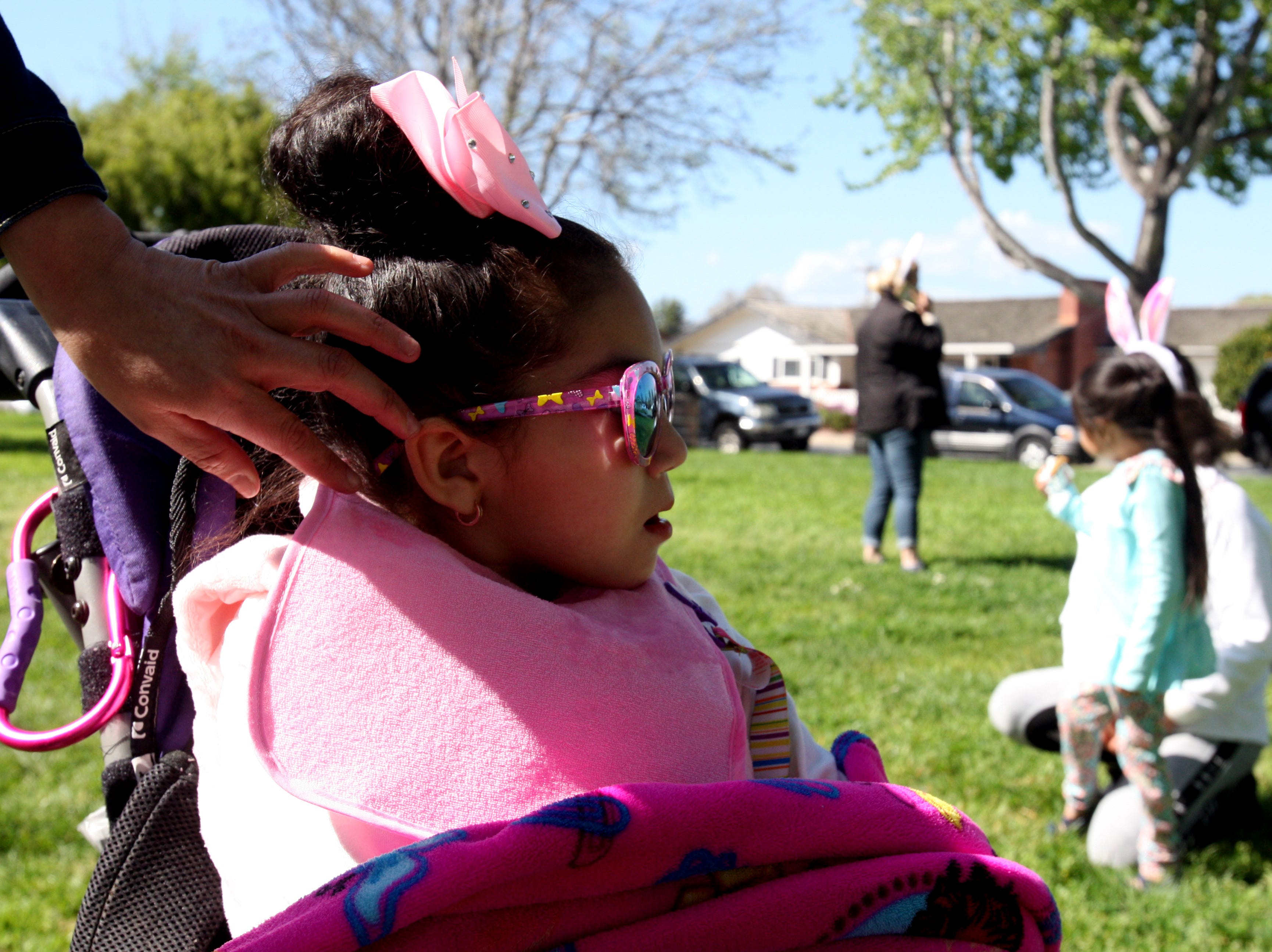 Vanessa Hernandez brushes her daughter's hair out of her face at the Easter Bunny Surprise Party for Salinas kids with life-threatening illnesses put on by Partnership for Children. Aaliyah Hernandez has Rhett syndrome, and Hernandez said events like this give her daughter and herself the opportunity to spend time with other special-needs moms and kids.