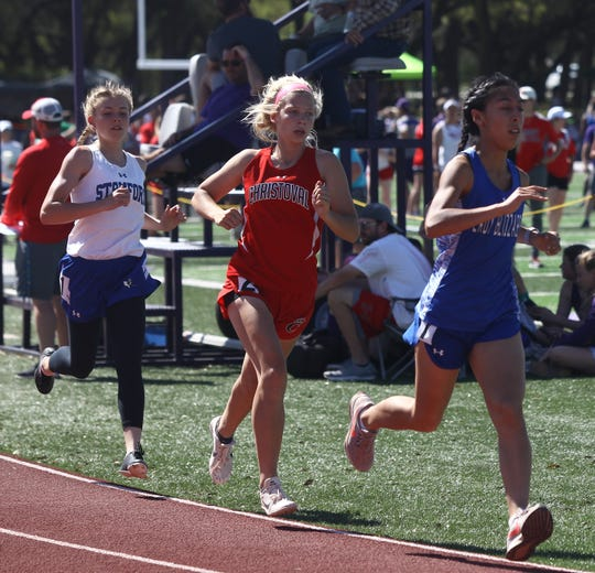 Winters High School's Natalie Lara and Christoval's Allison Vaughn come around the curve after the first lap of the girls 800 meters at the Districts 7&8-2A Area Track and Field Meet Wednesday, April 10, 2019 at Mertzon Irion County.