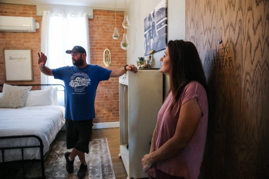 Jody and Michele Babiash walk through the Chiefs Retreat room Wednesday, April 10, 2019, at Old Central Firehouse Bed & Brew.