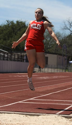 Miles' Skyler Brooks soars through the air to the pit during an attempt in the girls long jump at the Districts 7&8-2A Area Track and Field Meet Wednesday, April 10, 2019 at Mertzon Irion County.
