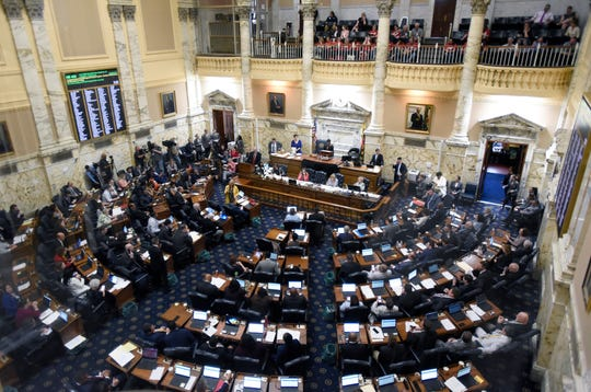 State delegates work in the Maryland House of Delegates chamber in Annapolis, Md., Monday, April 8, the final day of the state's 2019 legislative session.