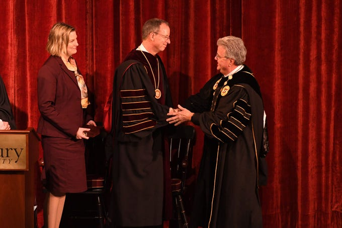 Dr. Robert Caret, University System of Maryland Chancellor, presents Dr. Charles A. Wight with the University Medallion during the inauguration as Salisbury University's ninth president on Wednesday, April 10, 2019 during a ceremony held at Holloway Hall on the campus of Salisbury University.