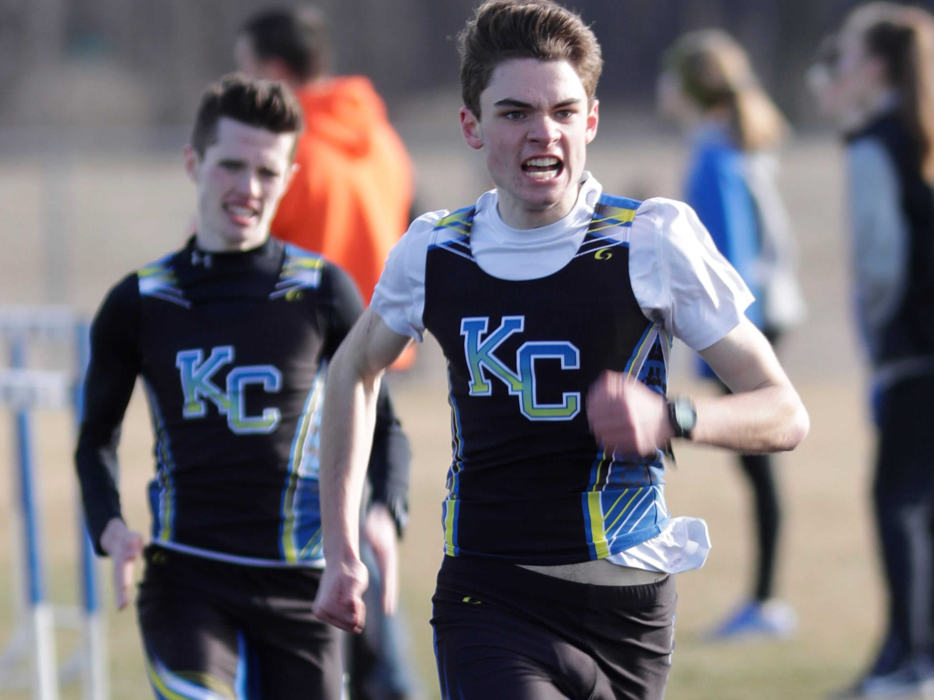 Kohler/Christian's Max Holmes and Henry LeBlanc at the end of the 1600 during the Howards Grove track meet, Tuesday, April 9, 2019, in Howards, Wis.