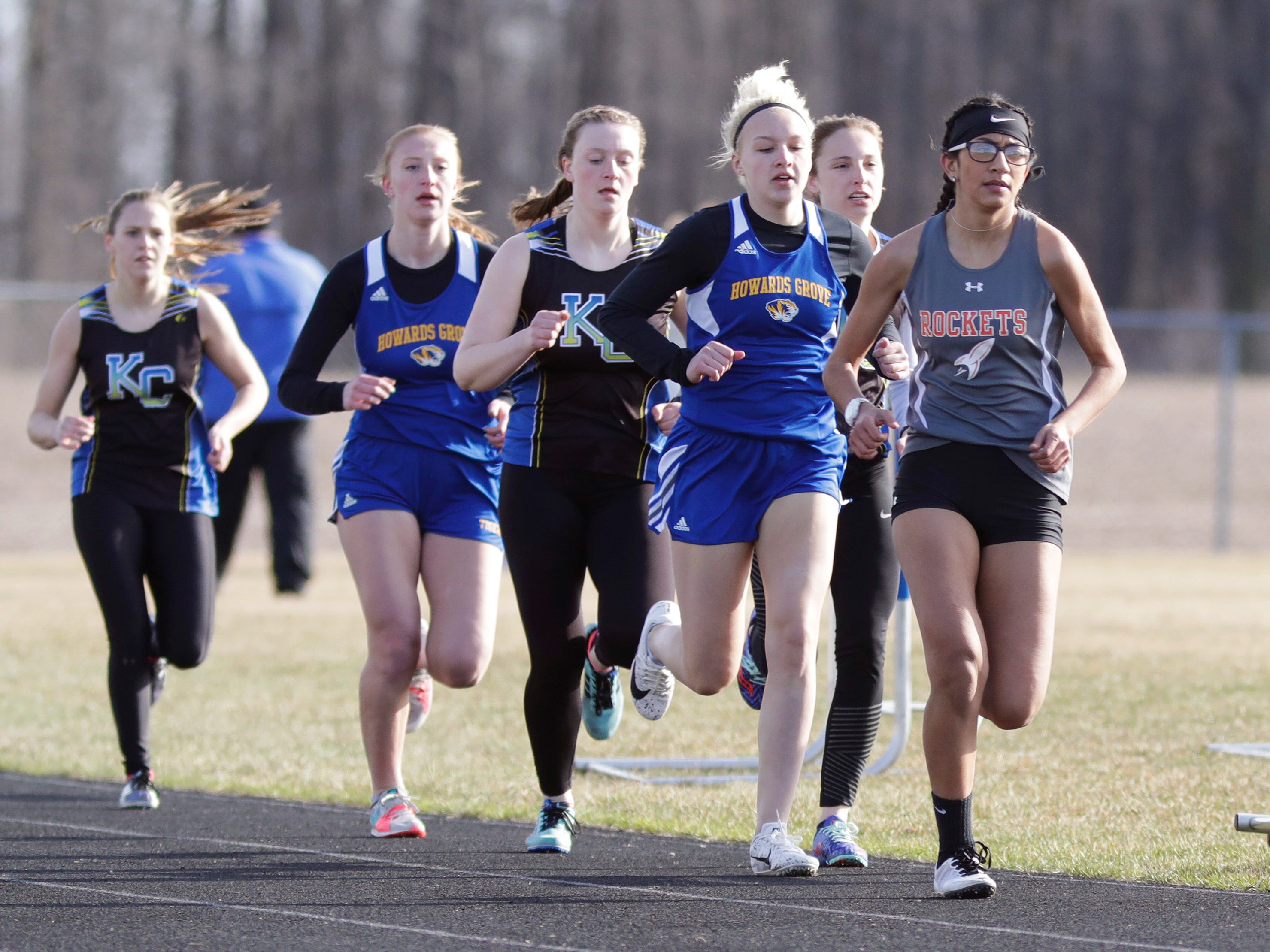 A scene from the girls 1600 meter run during the Howards Grove track meet, Tuesday, April 9, 2019, in Howards, Wis.