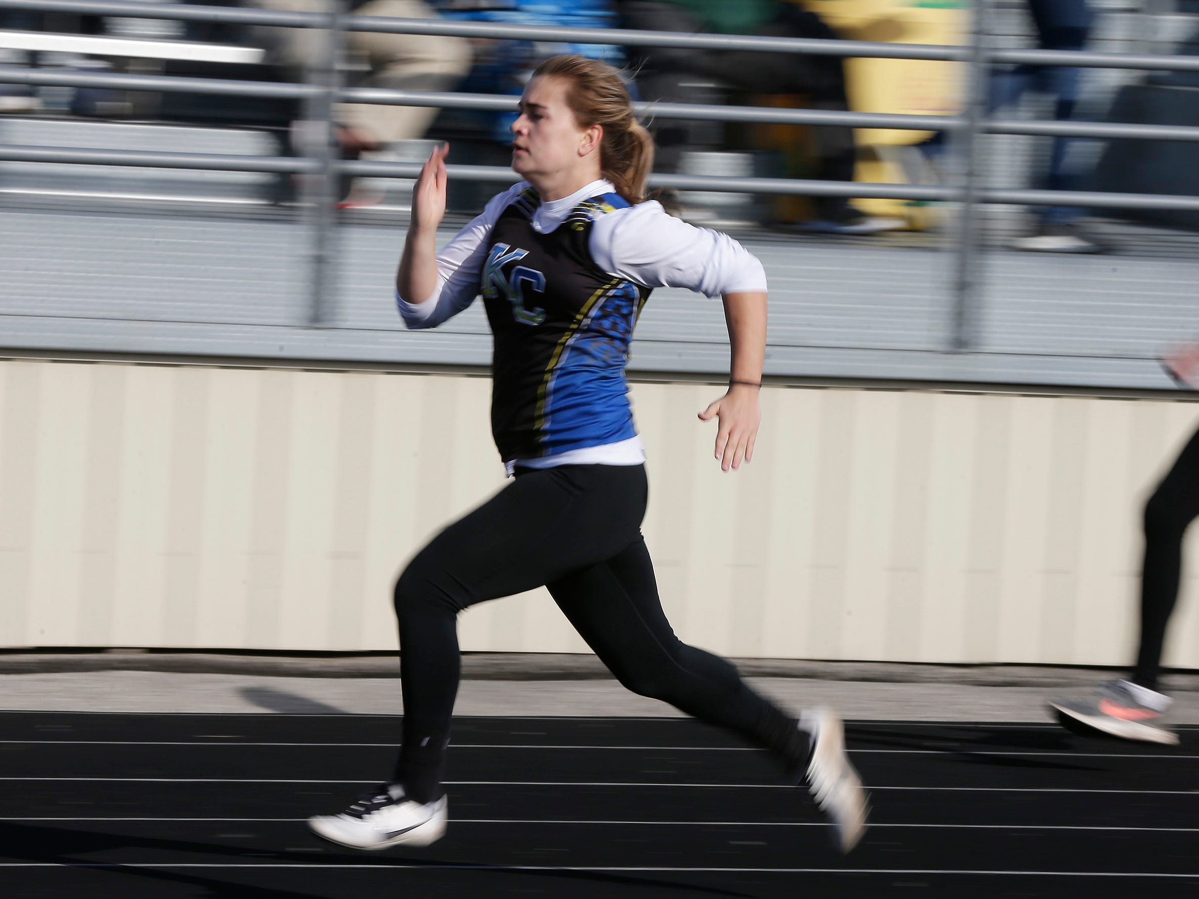 Sheboygan Kohler/Christian's Megan Moeller, left, sprints to win a heat in the 100 yard dash during the Howards Grove track meet, Tuesday, April 9, 2019, in Howards, Wis.