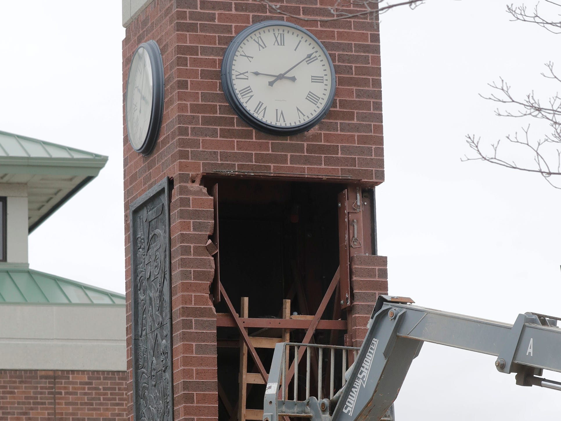 A scene from the removal of the 800-pound cast panels from the clock tower at Mead Public Library, Wednesday April 10, 2019, in Sheboygan, Wis. The city is repurposing the cast panels for an 8th Street display as part of a renovations project.