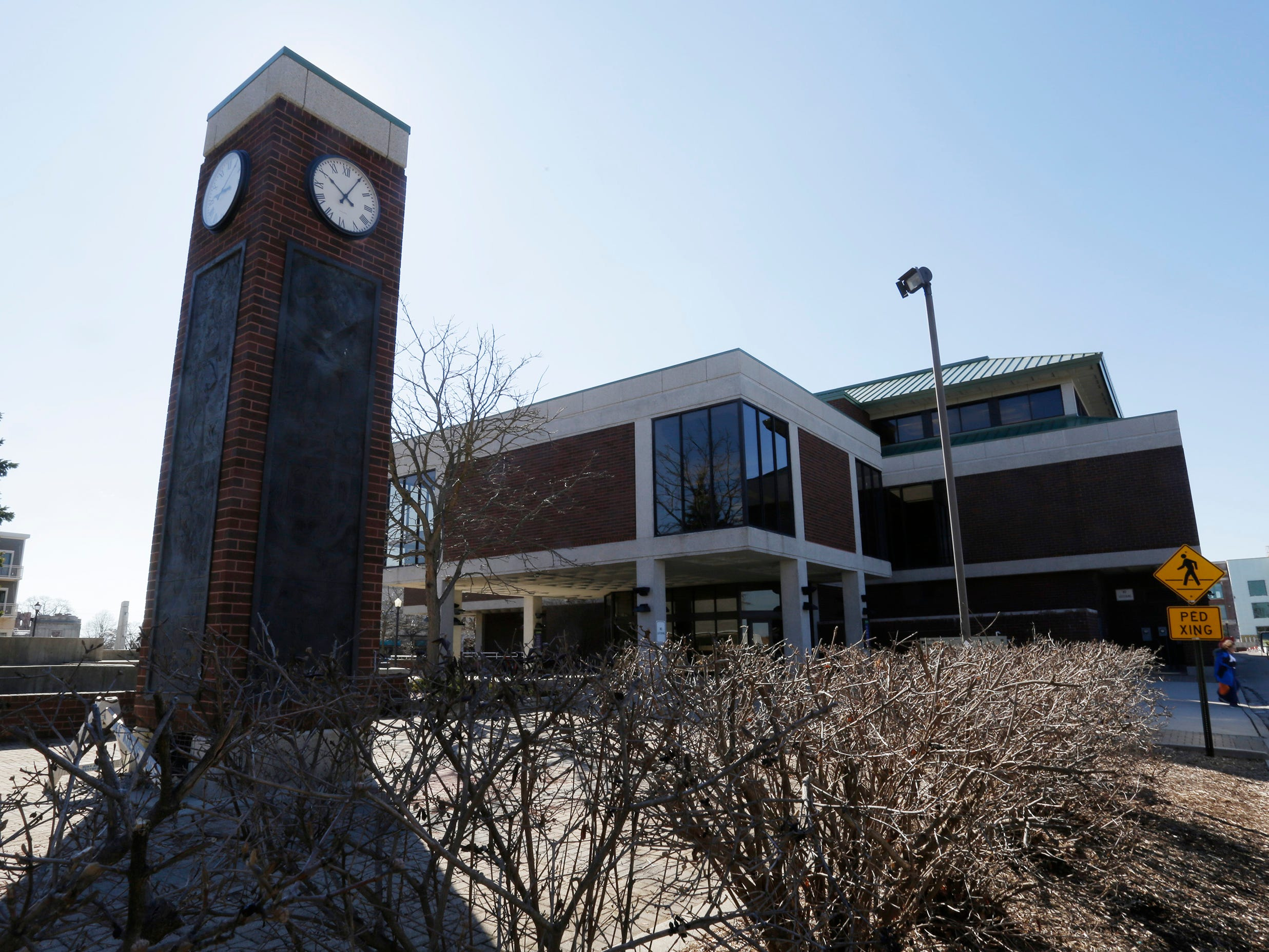 A view of the northwest side of Mead Public Library, Tuesday, April 9, 2019, in Sheboygan, Wis. In the foreground is the clock tower.