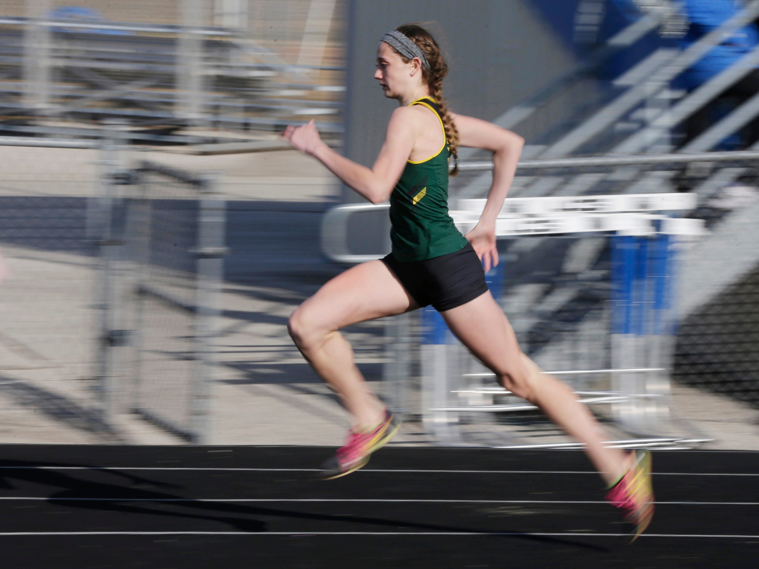 Sheboygan Lutheran's Carly Schreus is a blur of action during the Howards Grove track meet, Tuesday, April 9, 2019, in Howards, Wis.