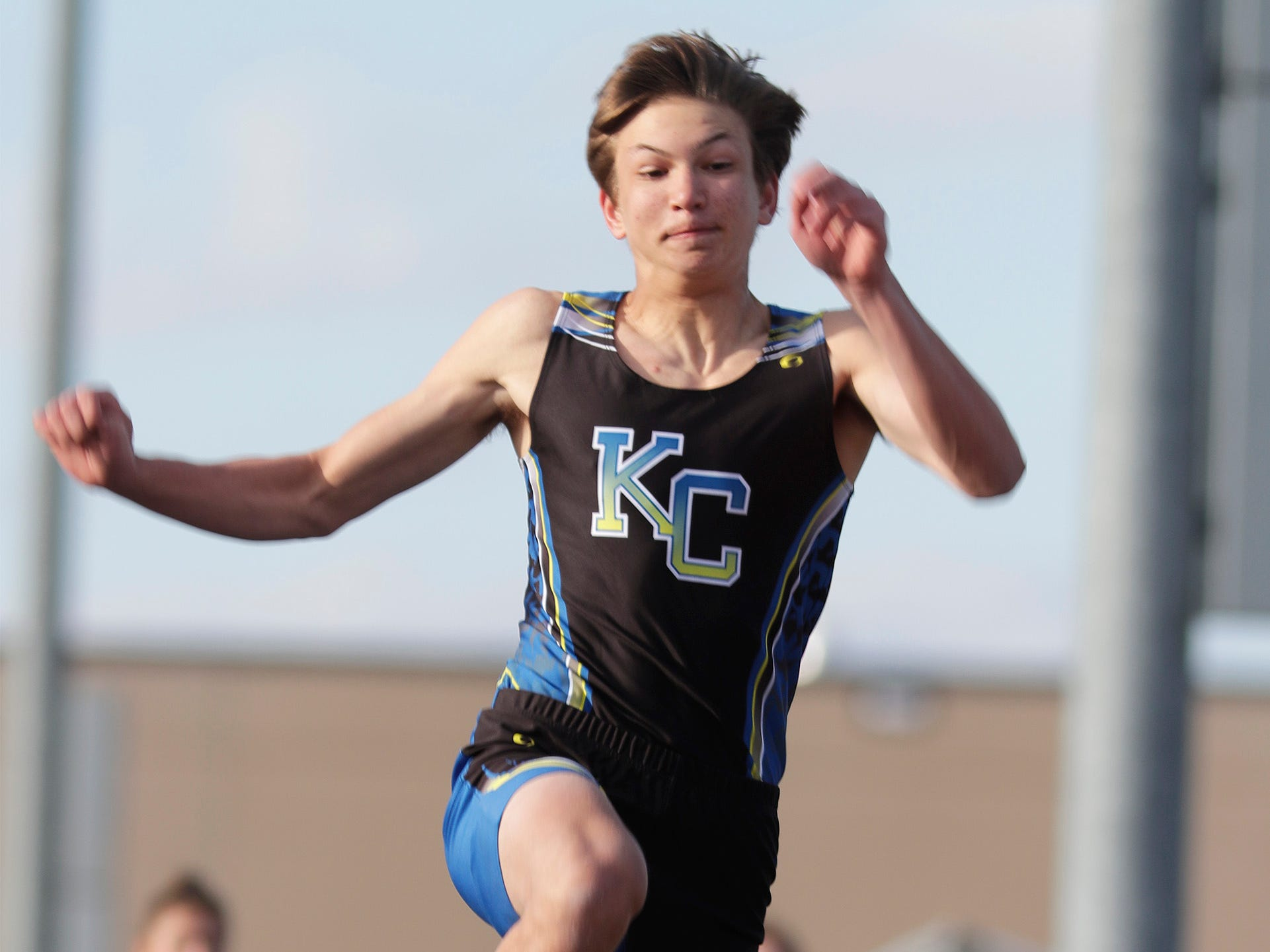 Kohler/Christian's Ben Toman leaps triple jump during the Howards Grove track meet, Tuesday, April 9, 2019, in Howards, Wis.