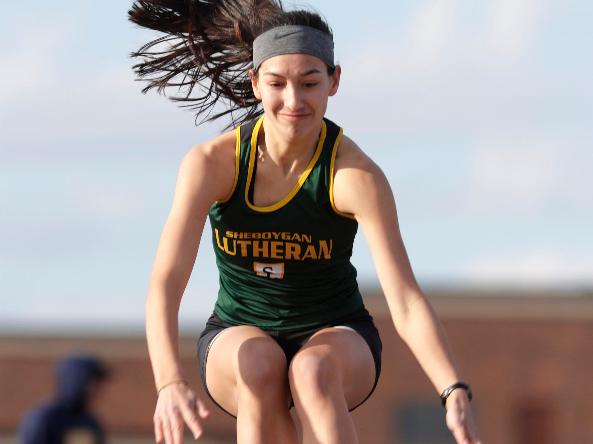 Sheboygan Lutheran's Emma Schmideler is airborne during her long jump attempt at the Howards Grove track meet, Tuesday, April 9, 2019, in Howards, Wis.