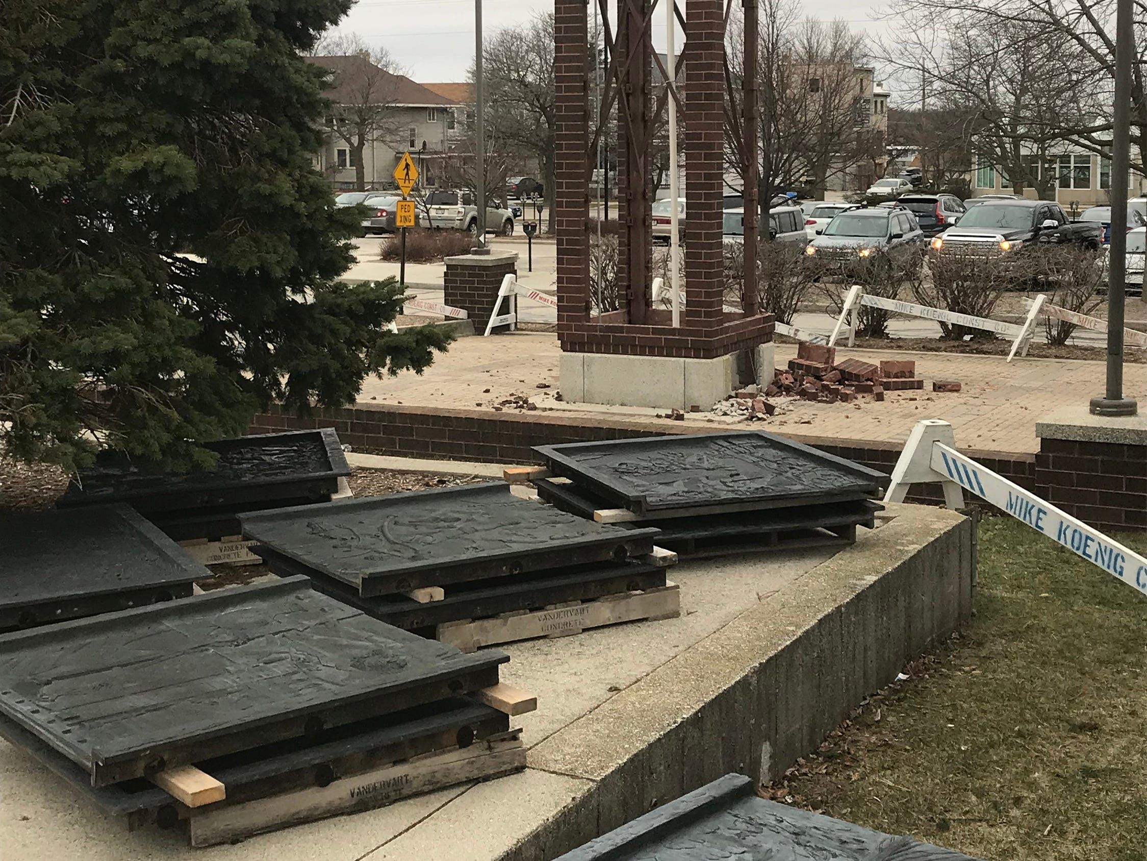 Panels that weigh 800-pounds each await storage following their removal from clock tower at Mead Public Library, Wednesday April 10, 2019, in Sheboygan, Wis. The city is repurposing the cast panels for an 8th Street display as part of a renovations project.