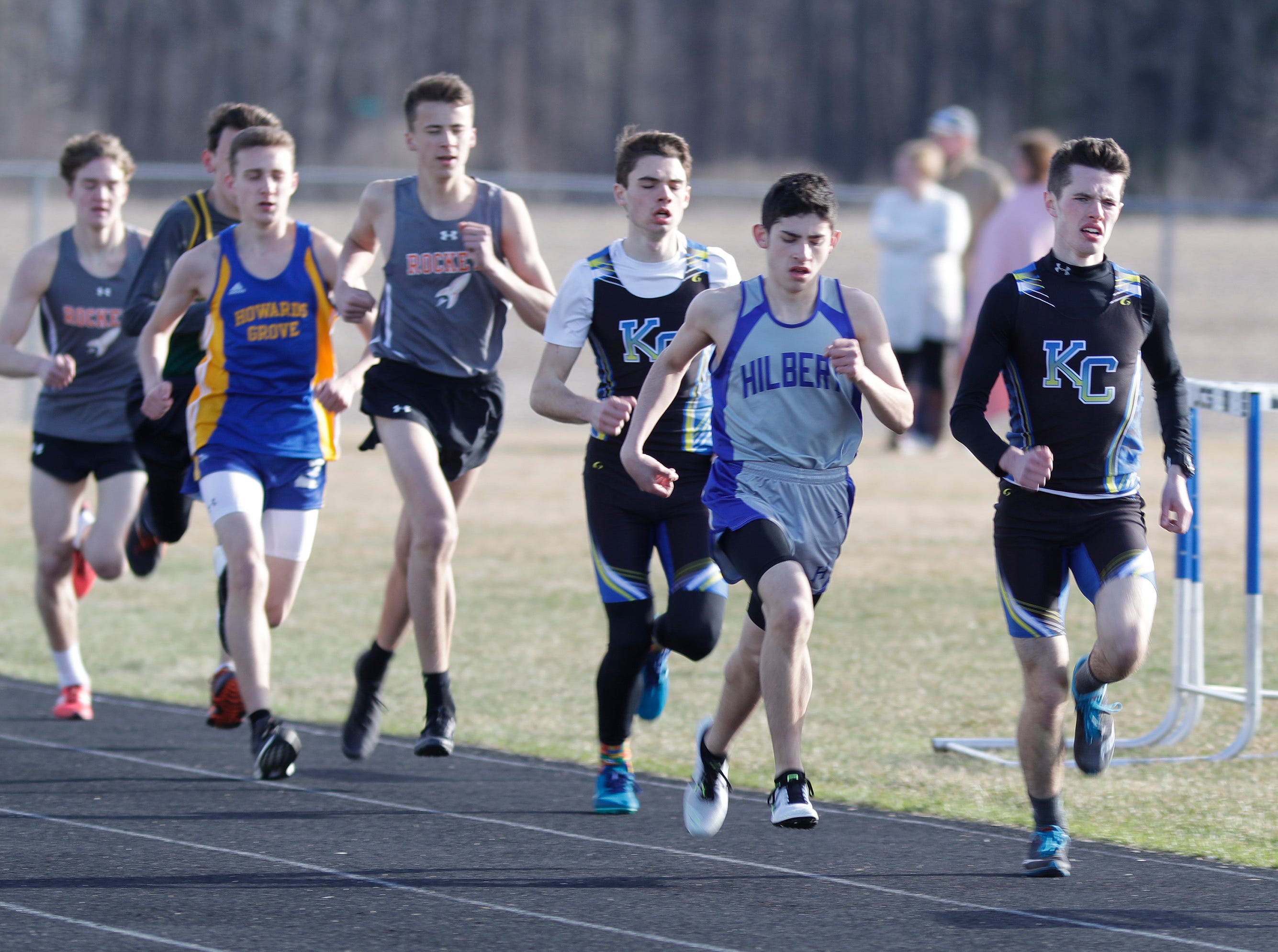 The pack runs the 1600 at the Howards Grove track meet, Tuesday, April 9, 2019, in Howards, Wis.