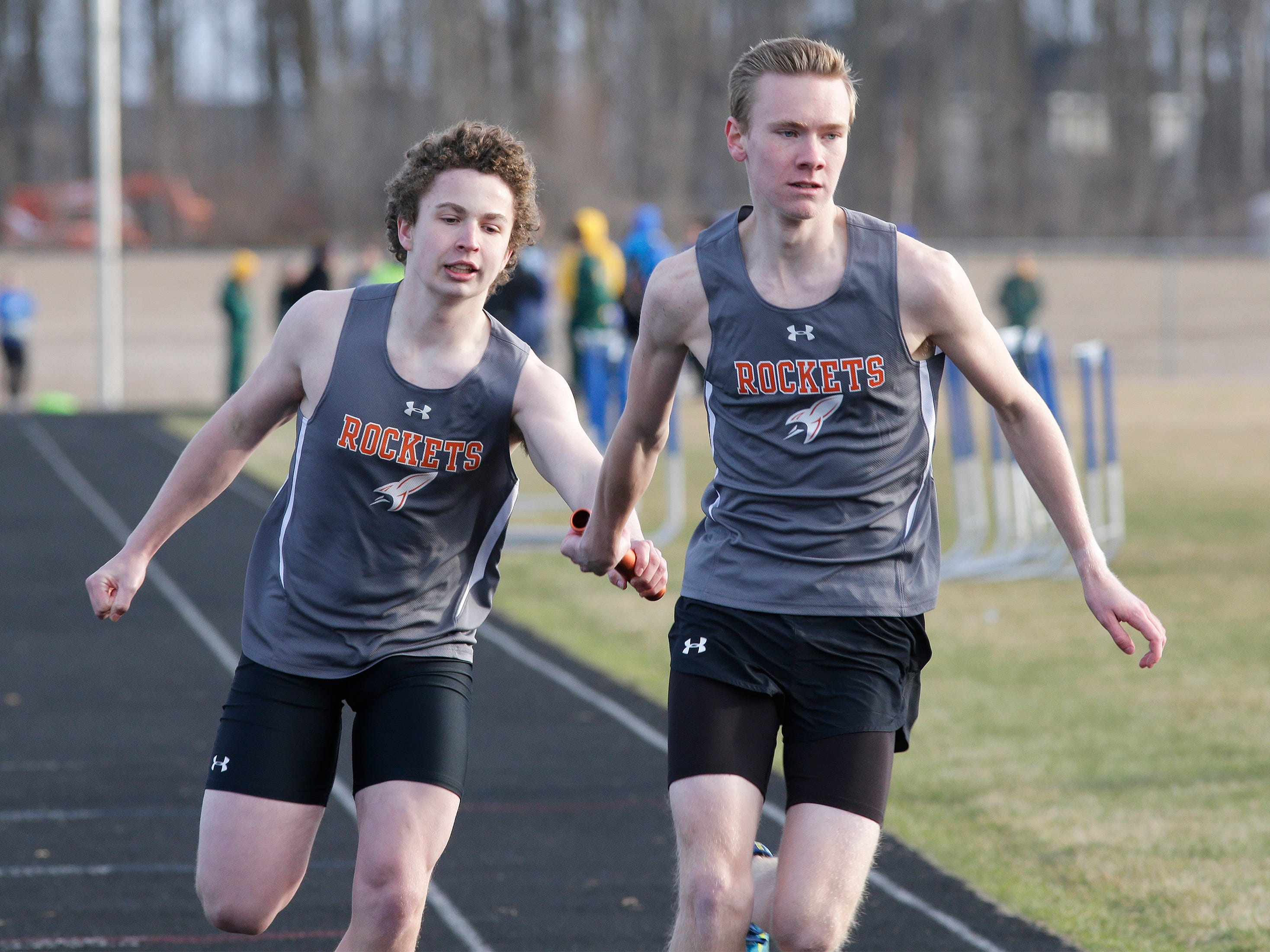 Cedar Grove-Belgium's Johnny Behrens, left, and Elliot Depies keep the pace in the 4 X 200 relay at the Howards Grove track meet, Tuesday, April 9, 2019, in Howards, Wis.