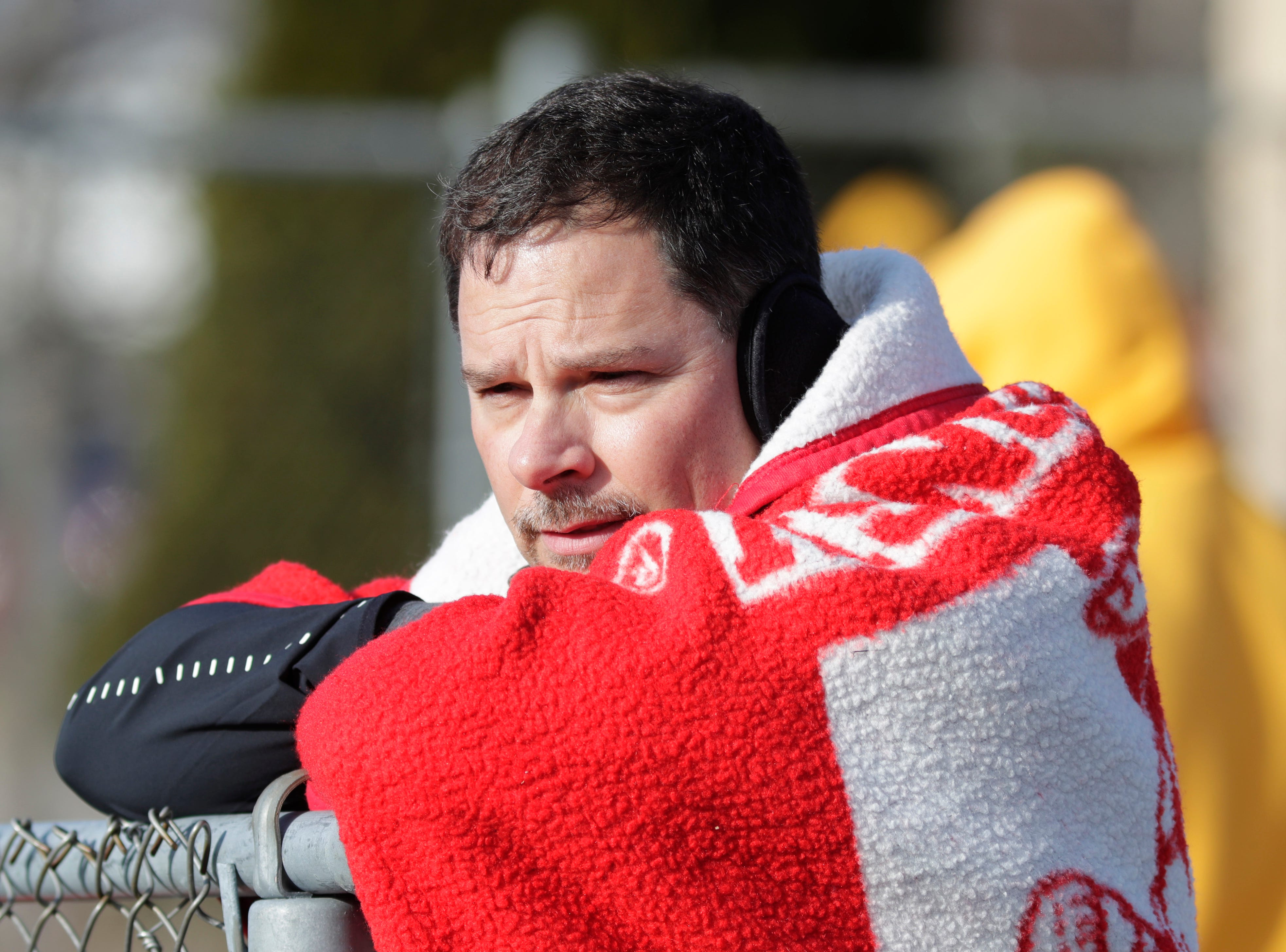 Daniel Bruhm watches action at the Howards Grove track meet, Tuesday, April 9, 2019, in Howards, Wis.