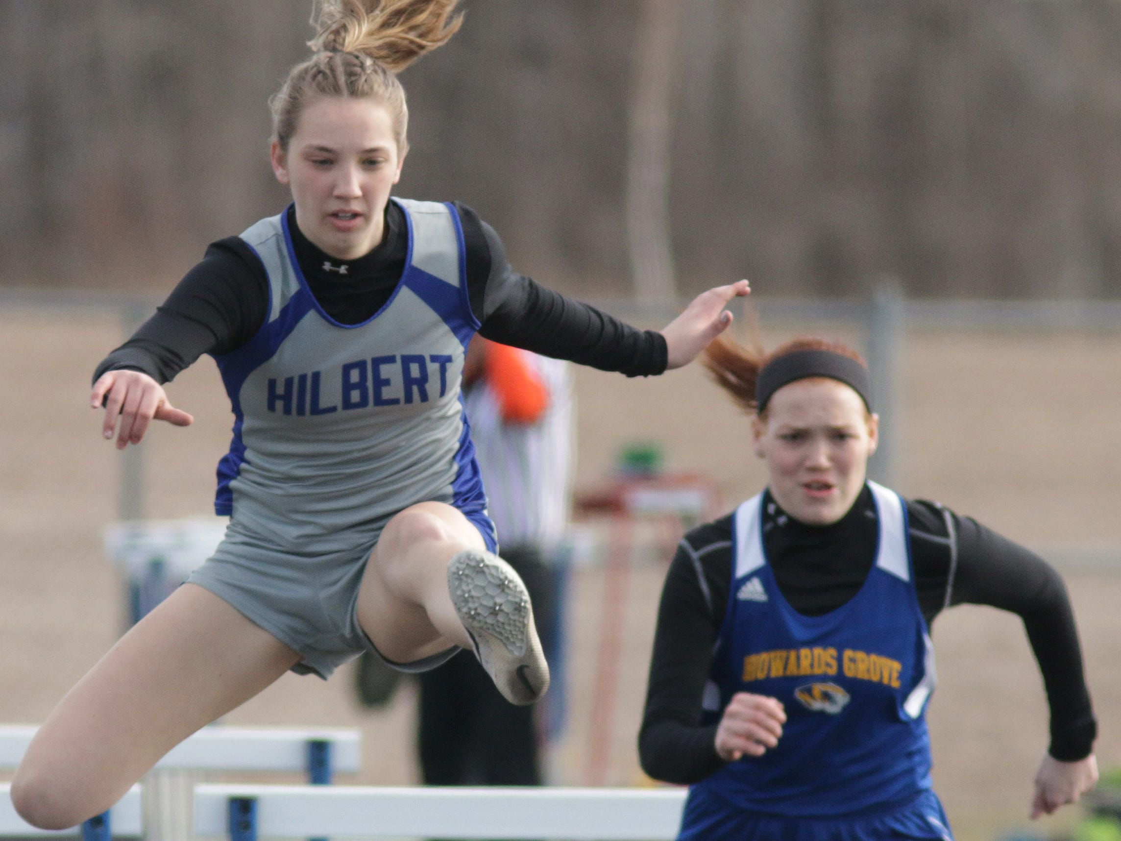 Hilbert's Heather Fry kept the pace during the high hurdles at the Howards Grove track meet, Tuesday, April 9, 2019, in Howards, Wis.
