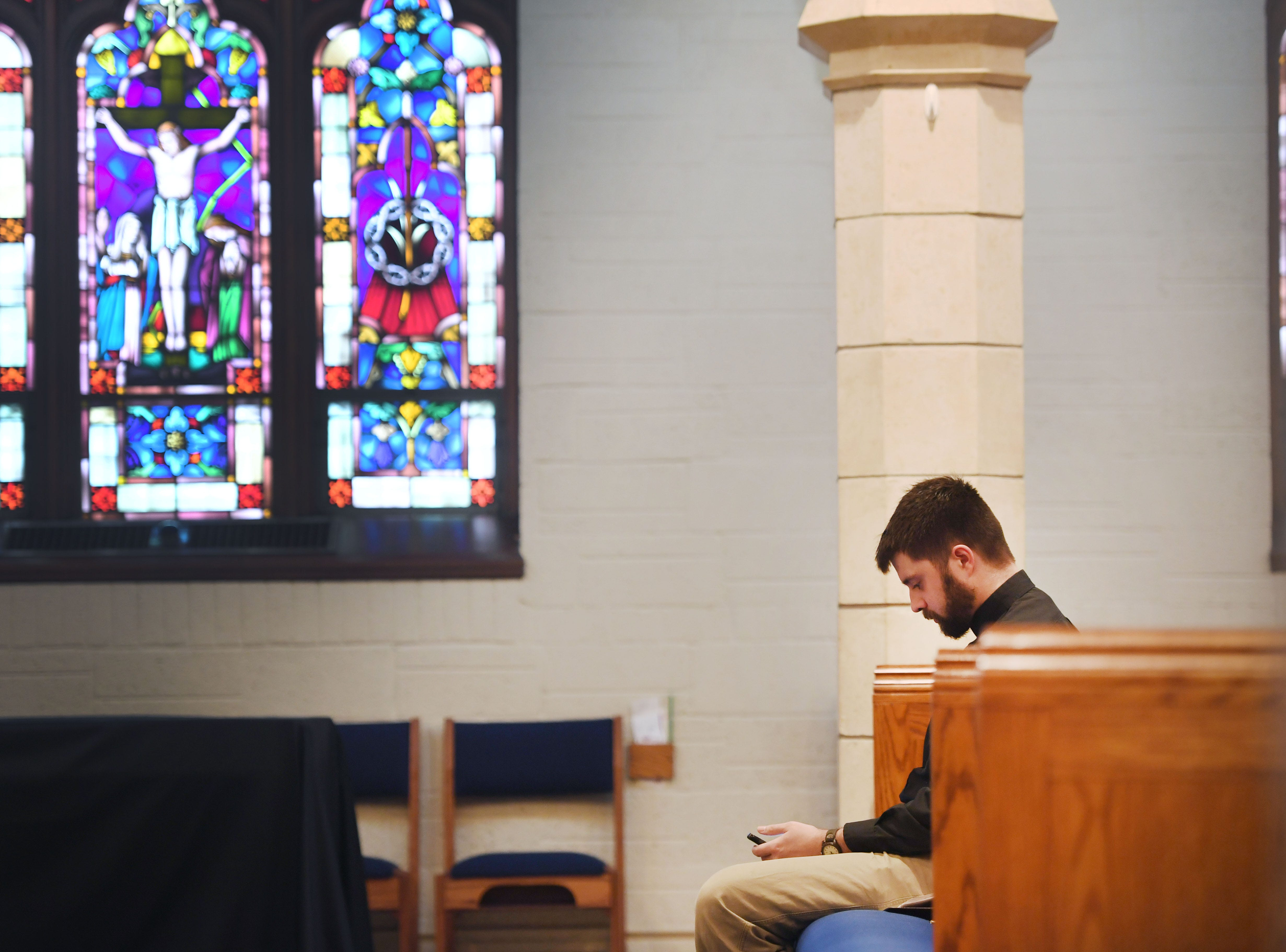 Pastor Josh Johnson sits in the pews before he gives a sermon during the noon service at East Side Lutheran Church Wednesday, April 10,  in Sioux Falls.