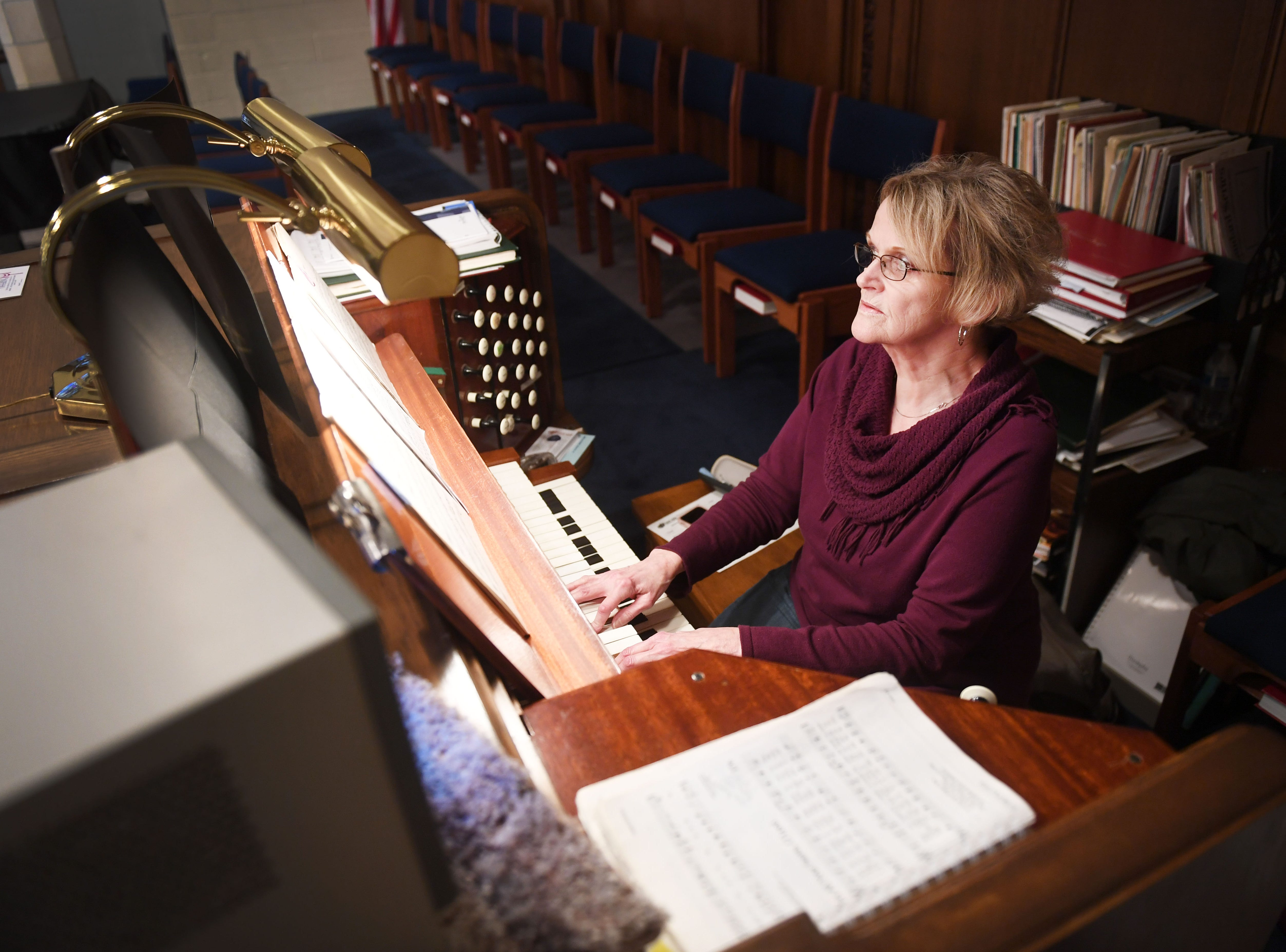 Organist Sandy DeSaix plays during the noon service at East Side Lutheran Church Wednesday, April 10, in Sioux Falls.
