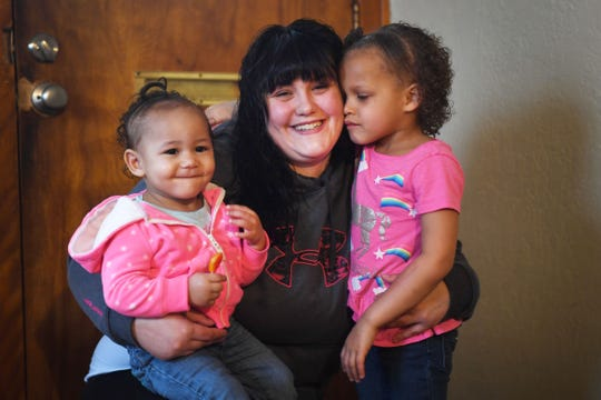 Hanah Christman and her daughters Aurora, 1, and Ciara, 4, Tuesday, April 9, in their home provided to them by a newÊlocal housing program, One Roof, in Sioux Falls. Christman said she is able to provide a stable life for her children now that they don't have to worry about where they are going to sleep night to night. Christman's two oldest children, not pictured were at school.