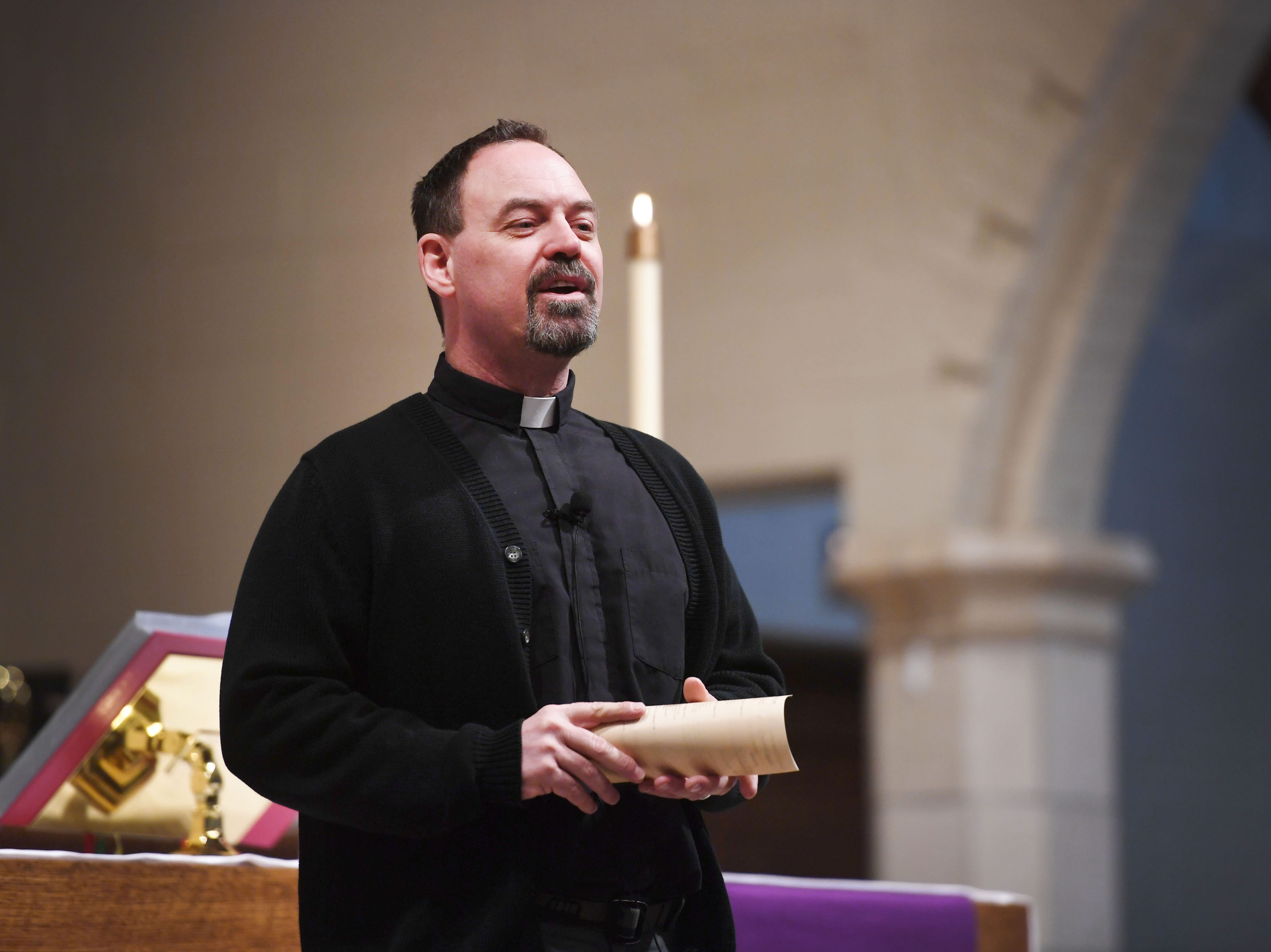 Pastor Layne Nelson does announcements at the beginning of the noon service at East Side Lutheran Church Wednesday, April 10,  in Sioux Falls.
