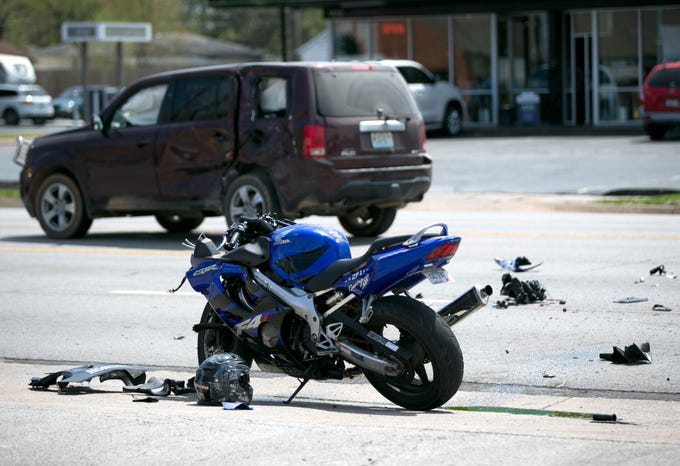 Emergency personnel respond to a crash between an SUV and a motorcycle near the intersection of Sunshine Street and Fremont Avenue on Wednesday, April 10, 2019.