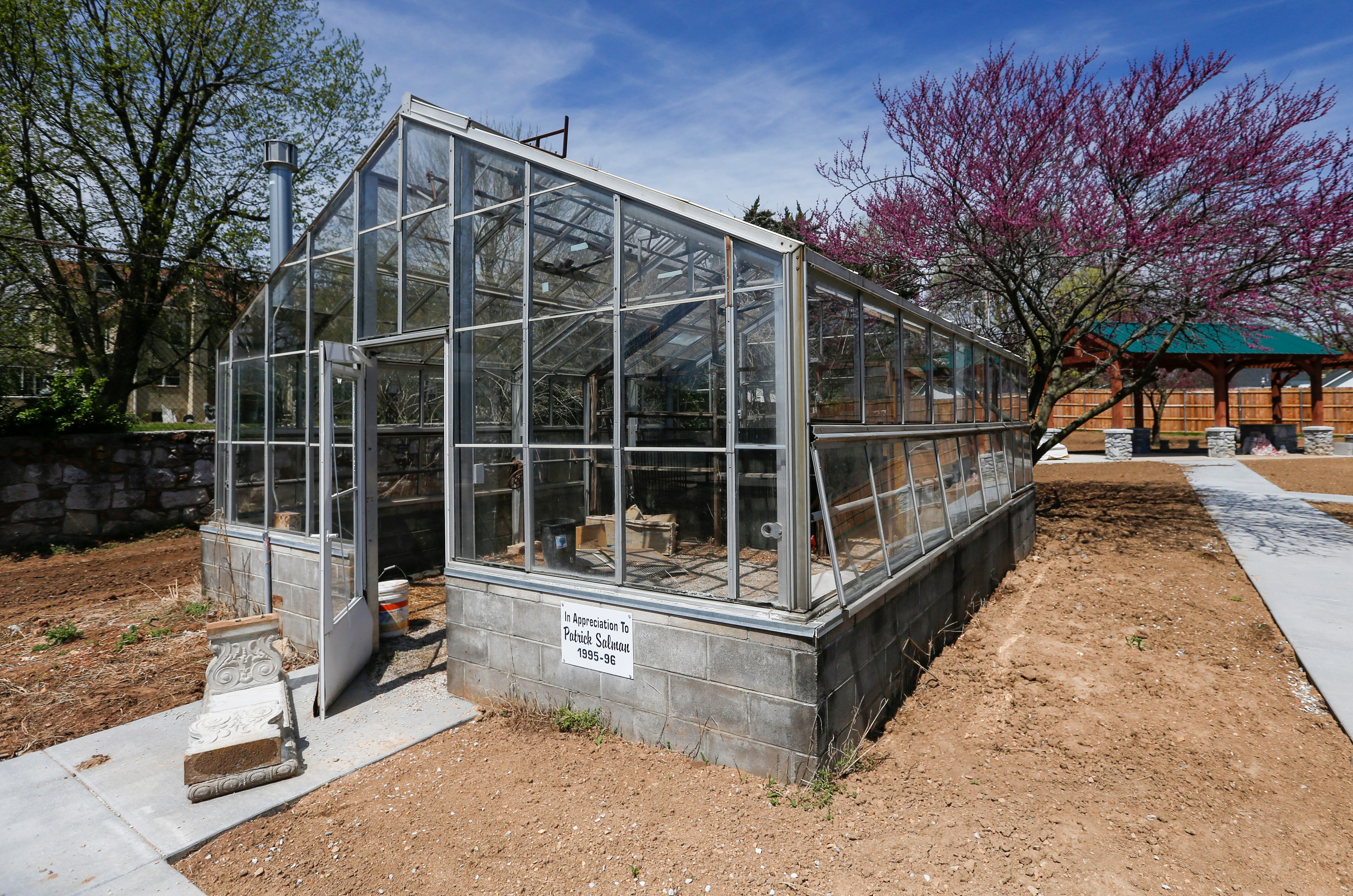 A greenhouse is located in the outdoor common area at the Bailey School Lofts on Central Street near Campbell Avenue.