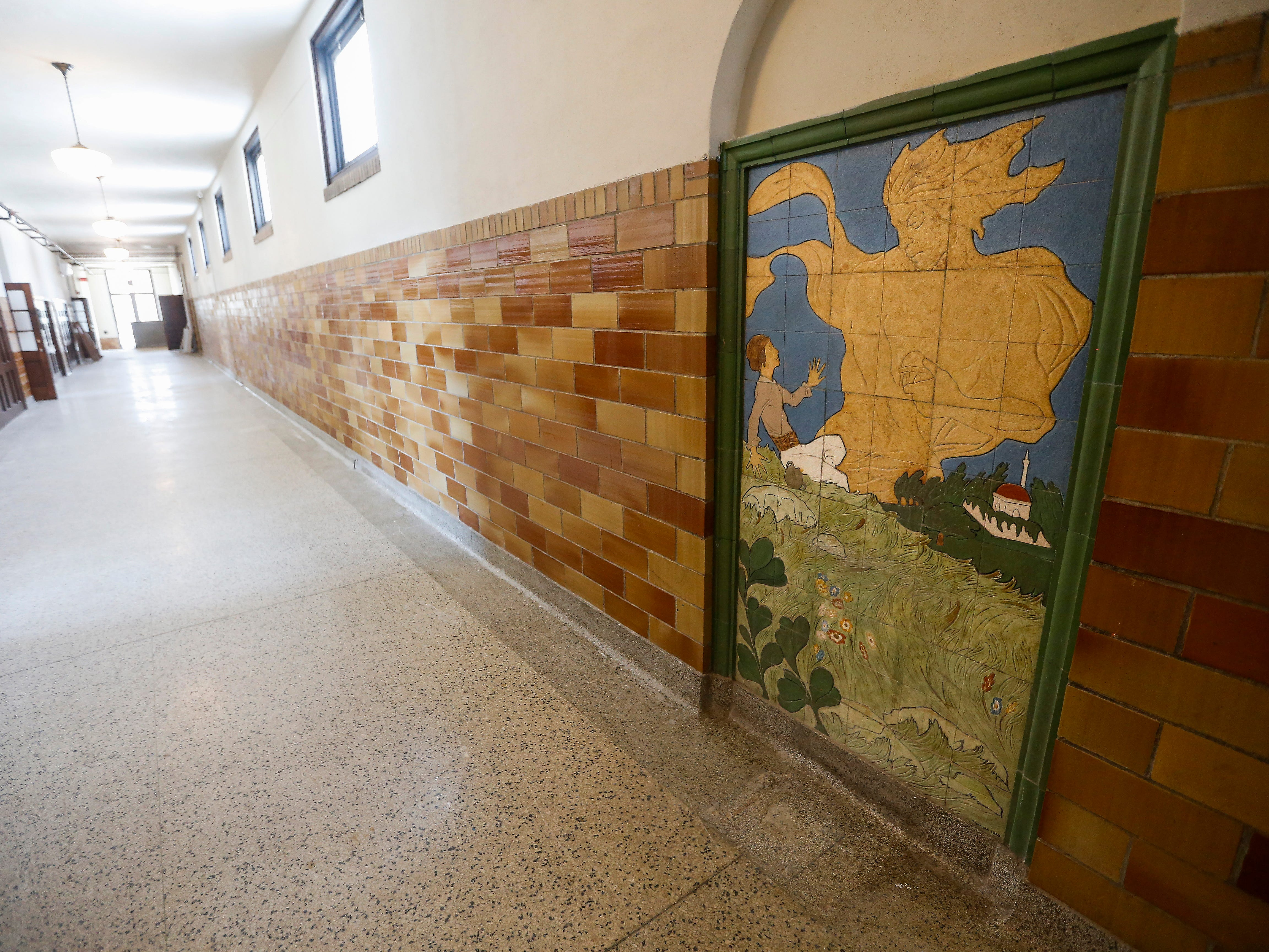 The murals at the Bailey School Lofts, located on Central Street near Campbell Avenue, have been kept in place.