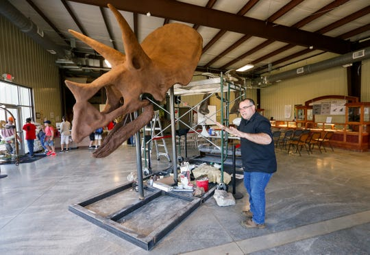 Matt Forir, director of the Missouri Institute of Natural Science, talks about the head of Henry the triceratops that they have just installed.
