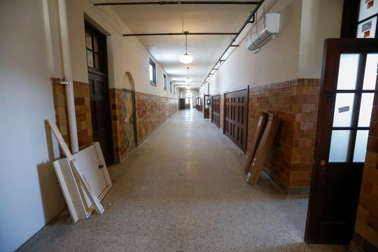 A look down the hallway on the second floor at the Bailey School Lofts on Central Street near Campbell Avenue.