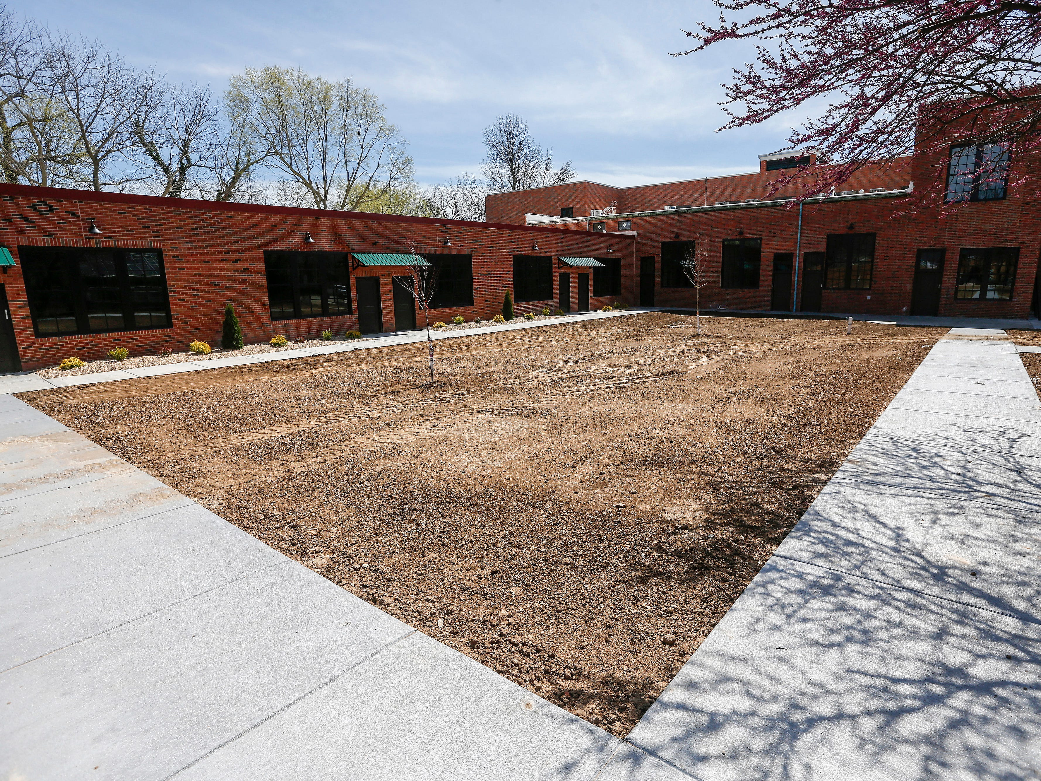 The outdoor common area at the Bailey School Lofts will be a park-like setting.
