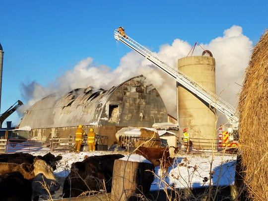 A photo depicts damage to the Norb and Marriette Walz barn after a Feb. 8 fire.