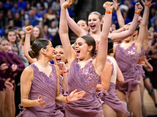Sartell senior Reese Schwarzentraub (arms extended) celebrates as the Sabres are named a finalist during the Minnesota Dance Team Jazz Tournament qualifying competition at the Target Center in Minneapolis. Schwarzentraub is the 2019 Times All-Area Dancer of the Year.