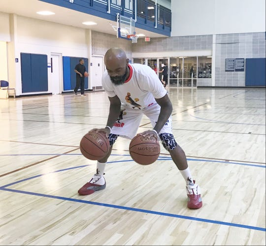 Dominique Farmer shows off his dribbling skills with both hands.