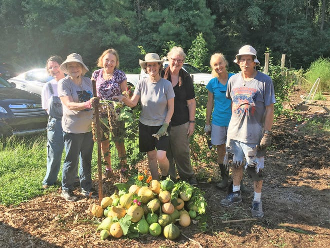 Our happy VegHeadz volunteer group after a day of work in the garden, led by the incredible Janis Piotrowski (center, black shirt).
