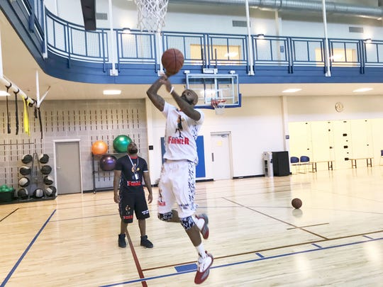 Dominique Farmer drives for a layup during his training at