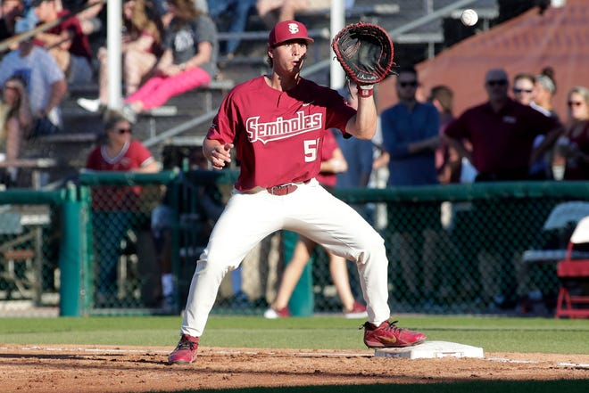 Florida State University Nico Baldor (51) secures the out at first base. The Florida State Seminoles host the Florida Gators Tuesday, April 9, 2019.