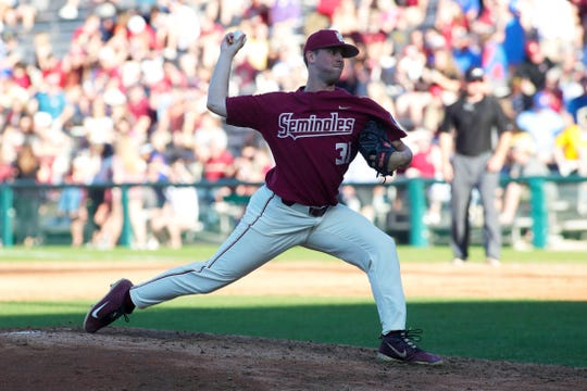 Florida State University Conor Grady (31) throws a pitch. The Florida State Seminoles host the Florida Gators Tuesday, April 9, 2019.