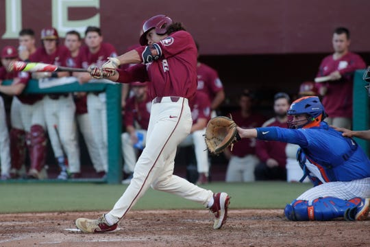 Florida State University Elijah Cabell (19) swings at the pitch. The Florida State Seminoles host the Florida Gators Tuesday, April 9, 2019.