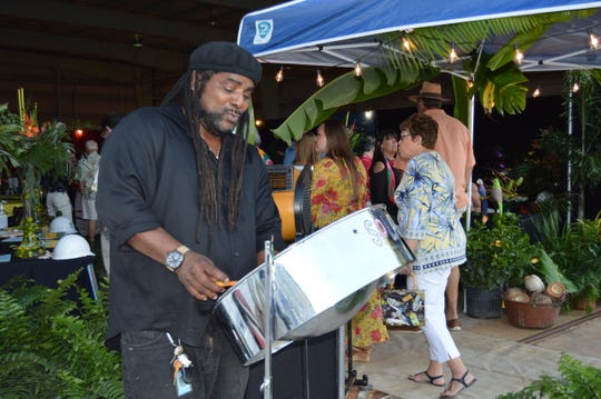 """Steel drummer Splash performs at Indian River Habitat for Humanity's """"Jamaican Me Crazy"""" fundraiser at the Sun Aviation Hangar."""