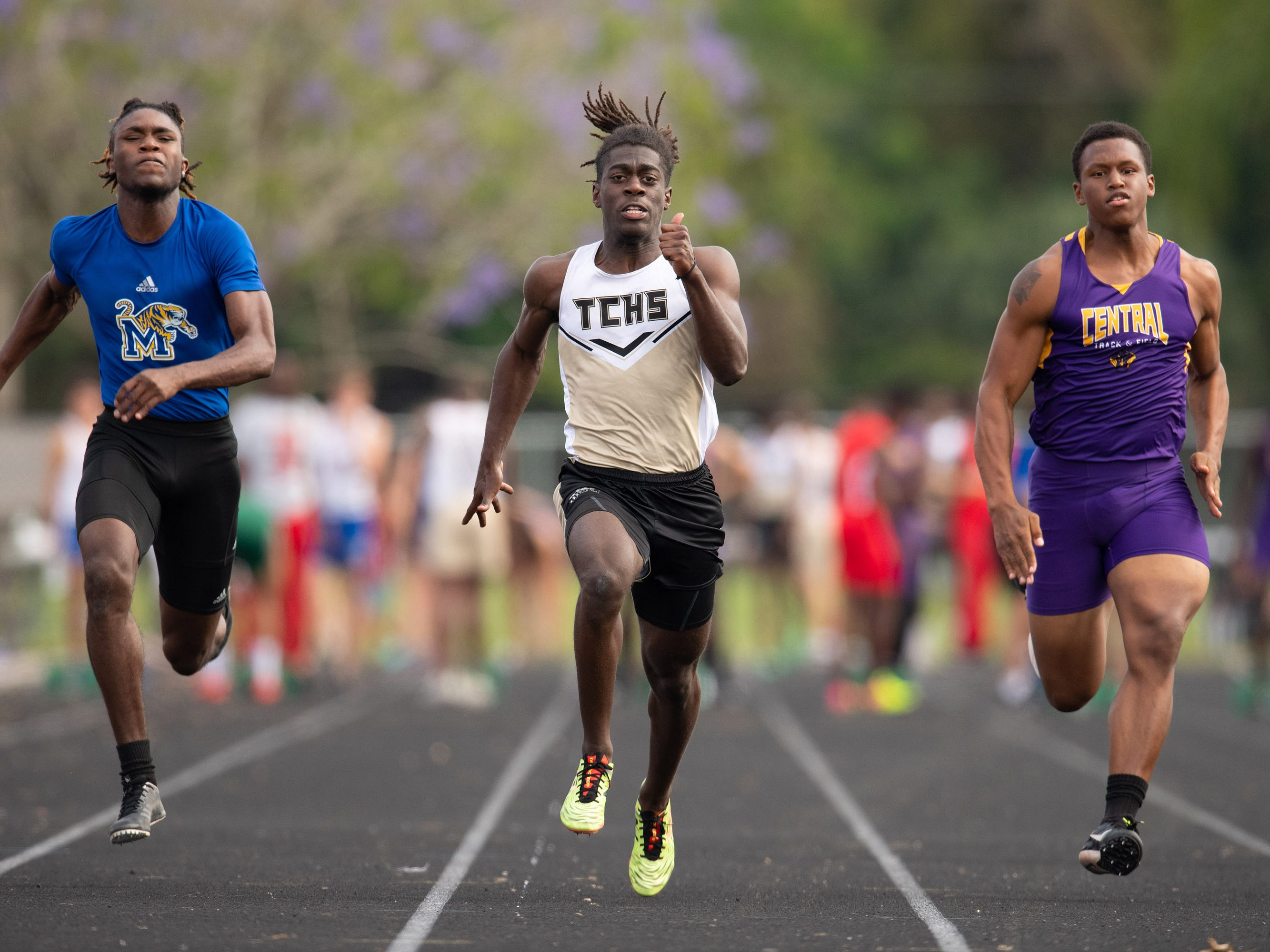Martin County's Fletcher Marshall (left), Treasure Coast's Sean Miller (center) and Fort Pierce Central's Kyle Hall compete in the 100 meter dash preliminaries during the District 9-4A Track Meet at Martin County High School on Wednesday, April 10, 2019, in Stuart. Miller won the heat.