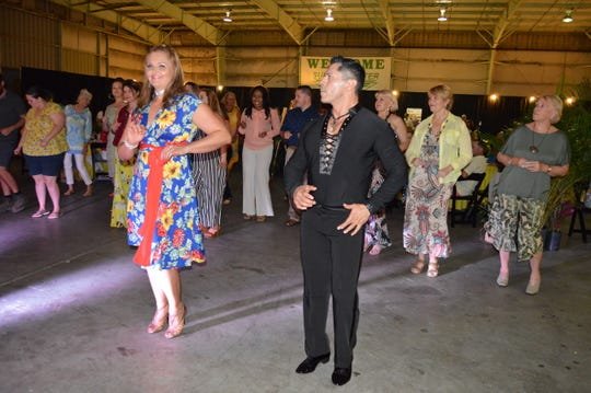 Guests at Habitat for Humanity's fundraiser enjoy learning some dance moves from Shari and Joe Tessier, owners of Vero's well-known 14th Avenue Dance Studio.