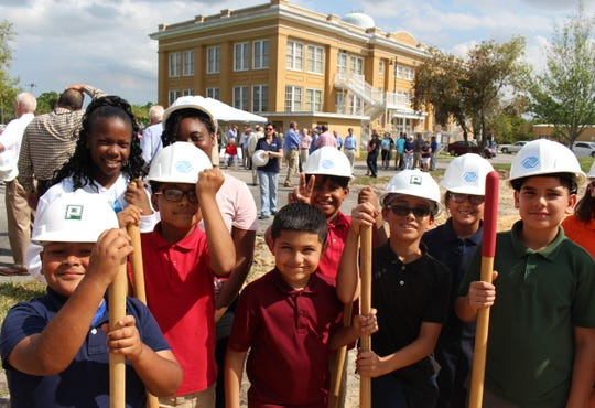 Members of the Fellsmere Boys & Girls Club prepare to break ground on a new club house in Fellsmere.