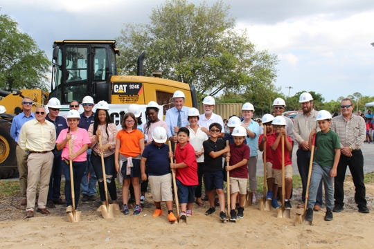 Fellsmere Boys & Girls Club children, staff, and stakeholders break ground on the new building in Fellsmere.