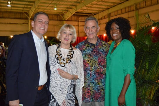 "Eric Flowers, left, Georgia Irish, Bill Penney and Eve Kyomya at Indian River Habitat for Humanity's ""Jamaican Me Crazy"" fundraiser at the Sun Aviation Hangar."