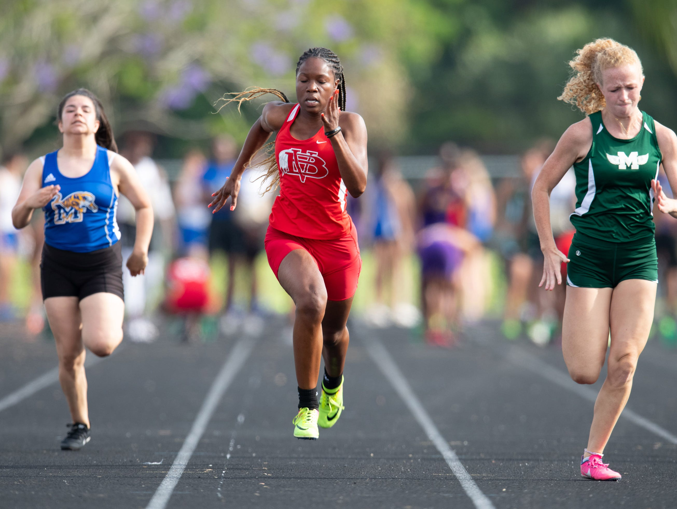 Athletes compete in the District 9-4A Track Meet at Martin County High School on Wednesday, April 10, 2019, in Stuart.