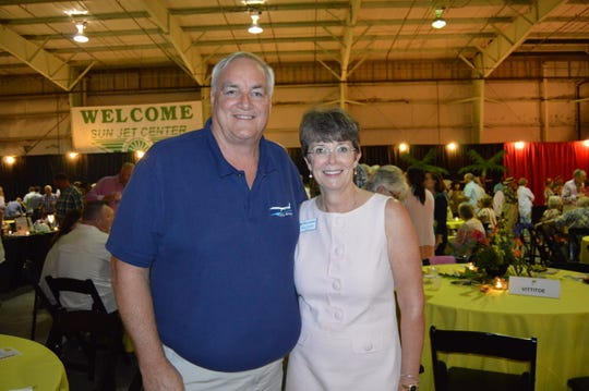 """John Pearsall and Sheryl Vittitoe attend Indian River Habitat for Humanity's """"Jamaican Me Crazy"""" fundraiser at the Sun Aviation Hangar."""
