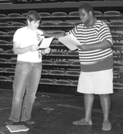 """Riverside Children's Theatre student actors rehearse for the production of """"Big River: The Adventures of Huckleberry Finn."""""""