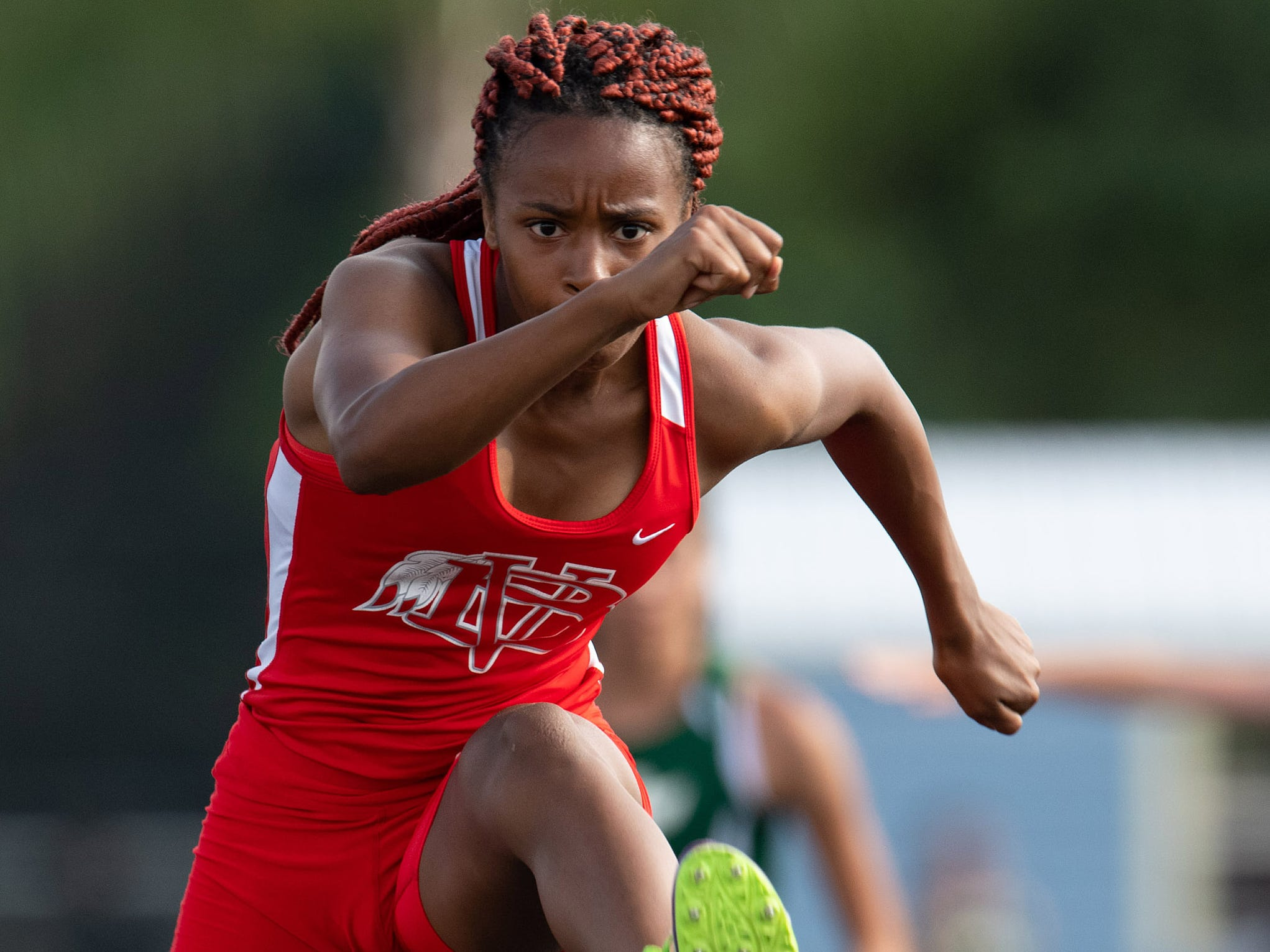 Vero Beach's Vonisha Kaigler competes in the 100 meter hurdle preliminaries during the District 9-4A Track Meet at Martin County High School on Wednesday, April 10, 2019, in Stuart.