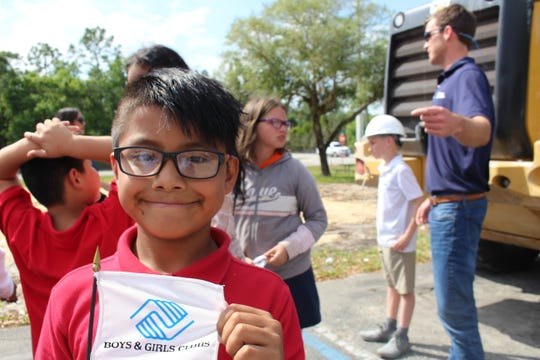 Fellsmere Boys & Girls Club member Jesus waits for the groundbreaking to start March 25.