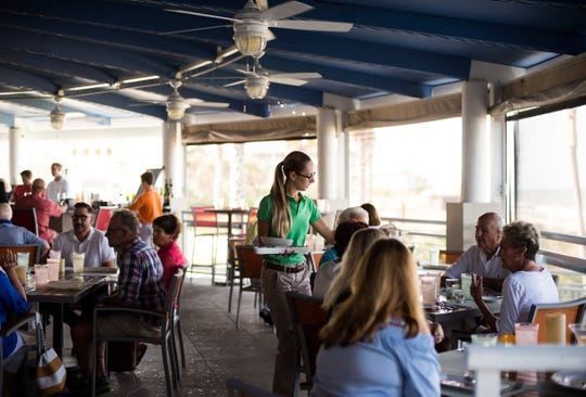Oceanfront restaurant Citrus, formerly Citrus Grillhouse, is photographed during dinner service Monday, April 8, 2019, at 1050 Easter Lily Lane in Vero Beach. Chef Scott Varricchio and wife Allison, who co-own the restaurant, have reopened after damage sustained during a fire forced them to close a year ago.